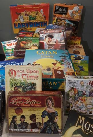 A giant pile of games that one could find at Kids Night Out